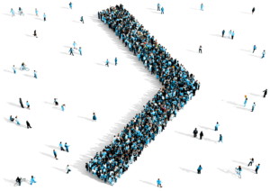 Schlüsselbild SAG – Menschen in Pfeilformation